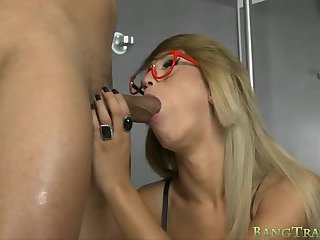 Busty shemale with glasses anal banged