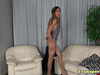 Glam tranny tugging herself after teasing