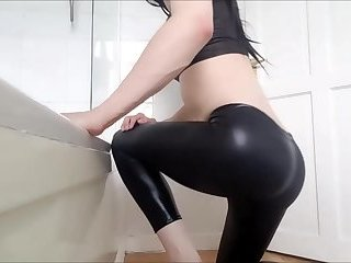 CD in shiny leggings takes a dildo