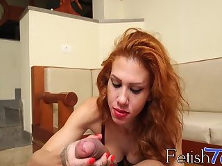 Redhead shemale sucks and tugs her lovers huge long dick