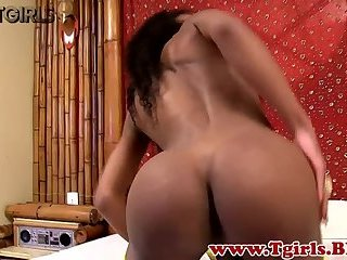 Gorgeous black mature tugs her chocolate cock