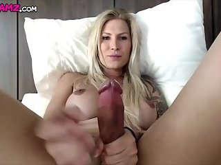 Sexy blonde Shemale Danni jerking huge dick