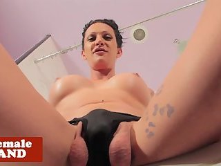 Inked shemale gently wanking her big cock