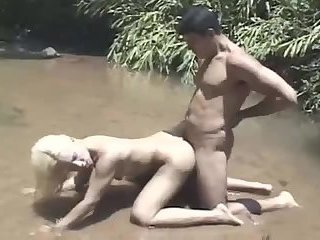 Cute blond tranny with Marcelao fucks in the river