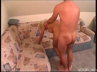 Blonde satisfies guy on couch