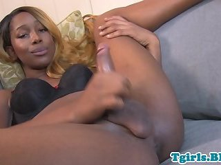 Ebony tgirl tugging her dick in solo scene