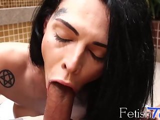 Stunning shemale with tattoos swallows big black cock in POV