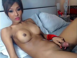 Amazing Asian Teen Strokes Her Hard Cock till She Cums
