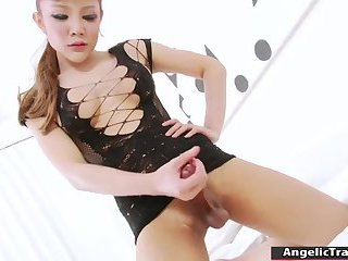 Trans Chanel D wears a seductive dress and jerks her huge shecock