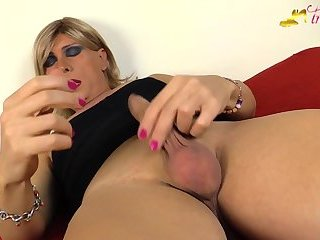 Blonde tgirl in black stockings masturbates with cumshot