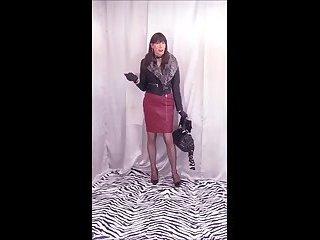 Dana cumming in her dark-red latex pencil skirt