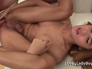 Long haired Asian ladyboy takes cum over her slim body