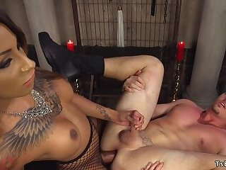 Latex tranny with big cock anal fucks guy