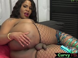 Bigtitted chubby trans tugging in stockings