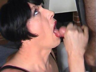 Mature dark haired crossdresser sucks cock