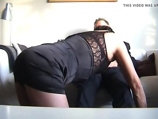 Mature dark haired crossdresser sucks cock