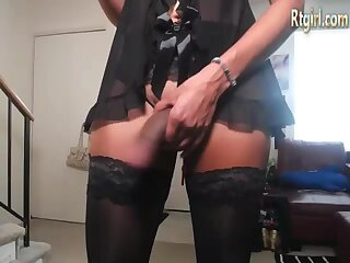 ebony tgirl in black stockings stands up and jerks off
