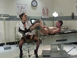 Busty tranny doctor bangs male patient