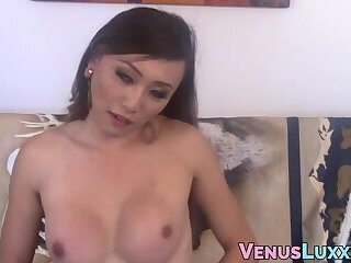 Shemale Asian beauty talks dirty during footjob