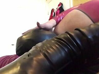 SLAVE SUCKING AND RIM FETISHTRANSEXUAL IN HER PORNSTAR CATSUIT RED PASSION OPEN ASS AND COCK