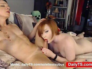 Redhead girl blows big dick femboy