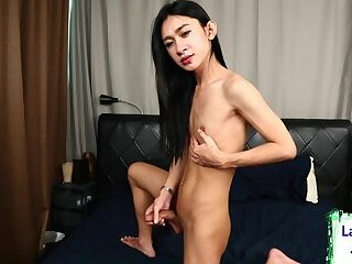 Asian tgirl takes off her panties for wank