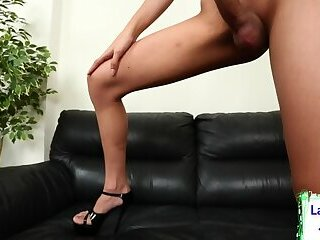 Redheaded ladyboy gets her big cock out