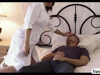 TS Domino Presley sucks her sleeping patients cock