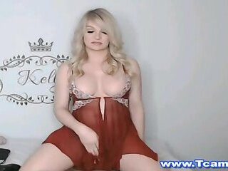 Tranny In Brown Dress Jerking Off In Bed