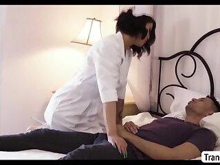 Hot Busty Nurse TS Domino Presley rides her patients cock