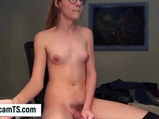 Nerdy SheMale From Next Door Does A Cumshot