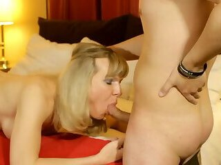 Blonde Shemale Takes Care of a College Boy