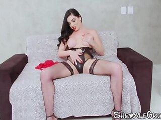 Tranny lady in black lingerie jerking her big dick off