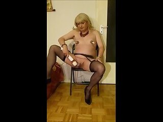 SilkeTrav in cage playing with a Hitachi