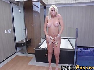 Busty tall shemale stroking her curved cock solo on camera
