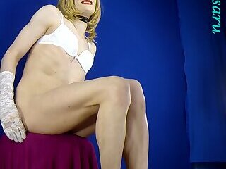 Blonde with bare legs in tan stockings, white lingerie