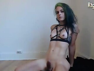 slender shemale Witch with green hair shows her hard dick and tight ass