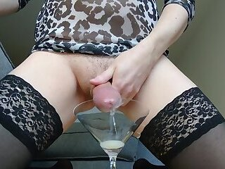 Sissy cums in a glass and drinks it