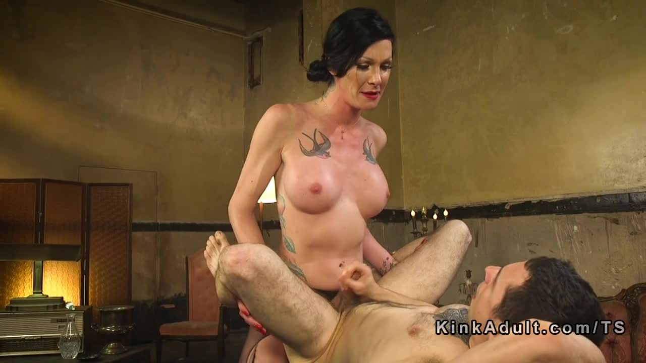 Tattooed big cock tranny anal fucks hairy guy